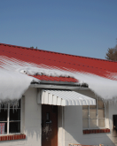 jalco snowguards - red metal roof with snow sliding down over windows
